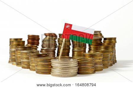 Oman Flag Waving With Stack Of Money Coins
