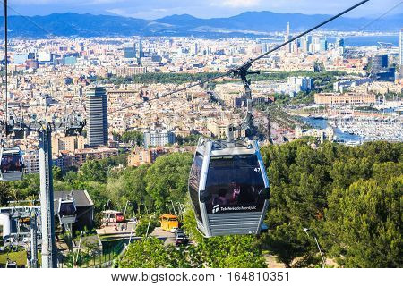 Barcelona, Spain - May 29, 2016: Montjuic funicular, panaramic view of Barcelona, Barceloneta area and seaport Vell de Barcelona on the background