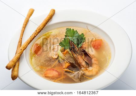 Soup With Shrimp In A White Plate.