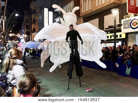 Torrevieja Spain - January 5 2017: Artist walk on stilts at Cavalcade of the Magi parade (The night of the Three Wise Men) in downtown of Torrevieja. The Cavalcade of Magi attracts thousands of visitors every year.