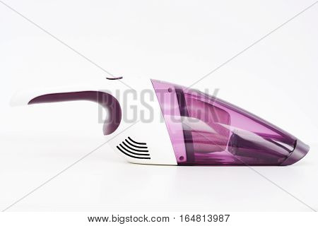 Purple hand held vacuum cleaner isolated on white background