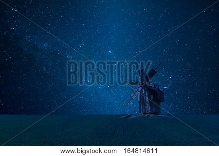 Night Landscape With Old Windmill And Stars