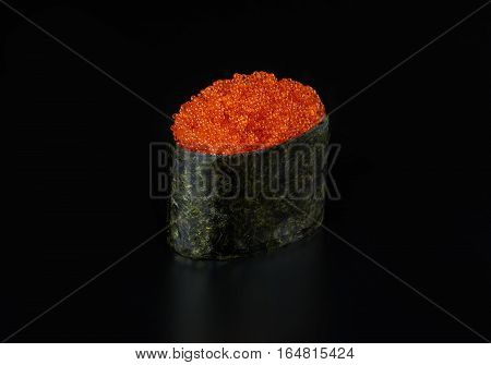 Flying fish roe tobiko roll gunkan isolated on black background
