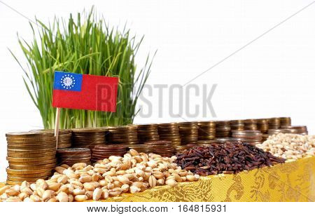 Myanmar Flag Waving With Stack Of Money Coins And Piles Of Wheat And Rice Seeds