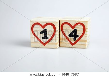 Wooden cubes with handwritten one and four inside red hearts. Valentine's day