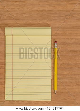 Bamboo Desktop with Yellow Pad and Pencil