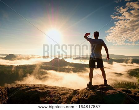 Young Sportsman Shadowing Eyes From Bright Sun, Mountain Summit