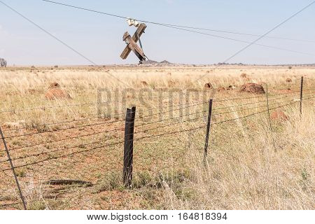 Obsolete telecommunications infrastructure damaged by fire near Petrusburg in the Free State Province of South Africa