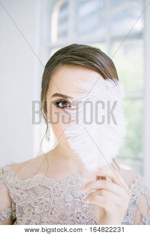 woman face portreit with feathers. bride morning