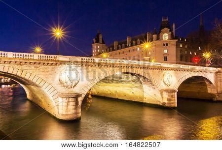 The pont Saint- Michel is a bridge linking the Place Saint-Michel on the left bank of the river Seine to the Ile de la Cite in Paris France. The present 62-meter-long bridge dates to 1857.
