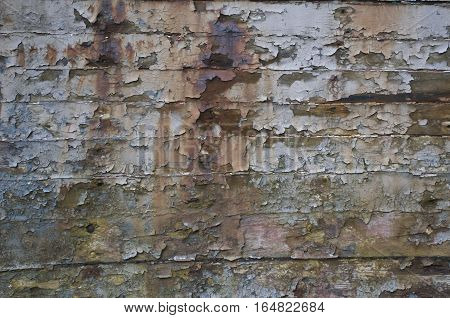 Faded Multicoloured pealing paint on old wood with rust and nails, Background, Texture