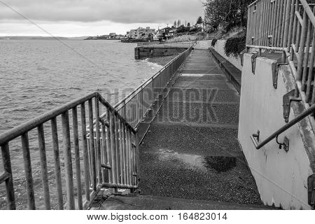 A view of a seawall walkway in West Seattle Washington.