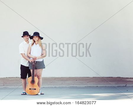 Relationship goals concept. Couple on romantic date. Man and woman standing with acoustic guitar