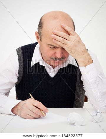 Elderly Man Writes, Draws Something On A Piece Of Paper, To Fill In An Application Or A Will. Think
