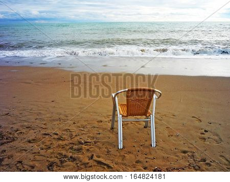 memories of summer a lonely chair standing on the beach