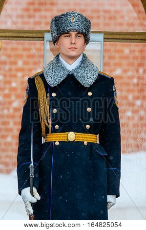 MOSCOW RUSSIA - JANUARY 05 2017: Guard of the Presidential regiment of Russia near Tomb of Unknown soldier and Eternal flame in Alexander garden near Kremlin wall. Winter view.