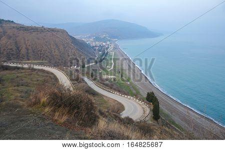 Coastal winding road sea in Crimea in autumn