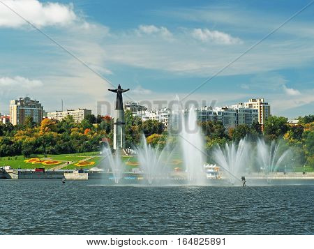 CHEBOKSARY CHUVASHIA RUSSIA - 13 SEPTEMBER 2015: A view of the fountains Cheboksary Bay and Monument Mother Protecting
