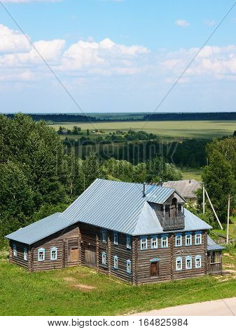 SIZMA VOLOGDA REGION RUSSIA - JULY 2014 Russian expanses. The old Russian merchant village ancient wood farmstead