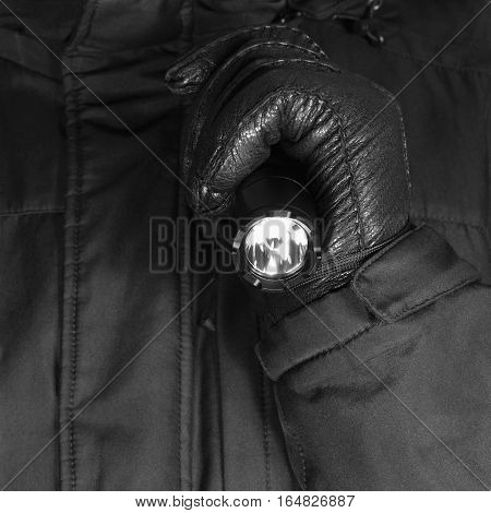 Gloved Hand Holding Tactical Flashlight, Bright Light Emitting Brightly Lit Serrated Strike Bezel, Black Grain Leather Glove And Cop Jacket, Large Detailed Vertical Closeup, Patrolling Police Security Guard Staff Policeman, Covert Operations