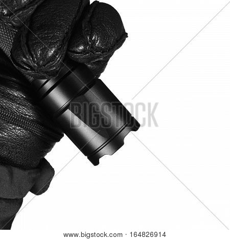 Gloved Hand Holding Tactical Flashlight, Bright Light Emitting Serrated Strike Bezel, Black Grain Leather Glove And Cop Jacket, Large Detailed Isolated Vertical Closeup, Patrolling Police Security Guard Staff Policeman, Covert Operations Patrol