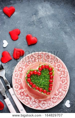Romantic salad shaped heart on Valentines Day Love food concept