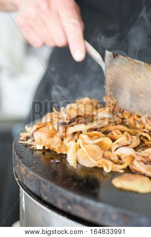 Glazed Chopped Onions Cooking On Skillet