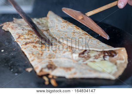 Cooking Crepe On Skillet Being Folded