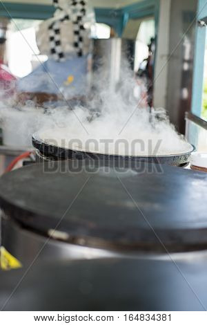 Steaming Crepe Cooking On A Hot Griddle