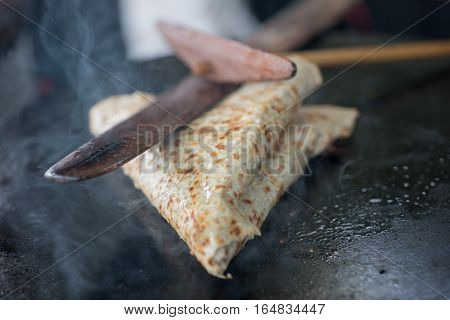 Closeup Of Folded Crepe Pressed With Wooden Tools