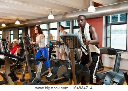 young people working out at the gym