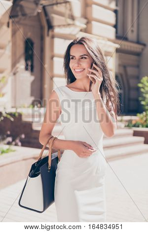 Young Pretty Business Woman Talking On Smartphone On The Street