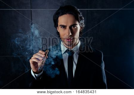Portrait Of Brutal Handsome Man  Smoking A Cigar