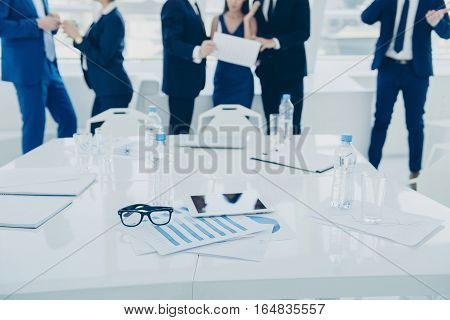 Close Up Of Conference Table Of  Business People Discussing  Results Of Their Work
