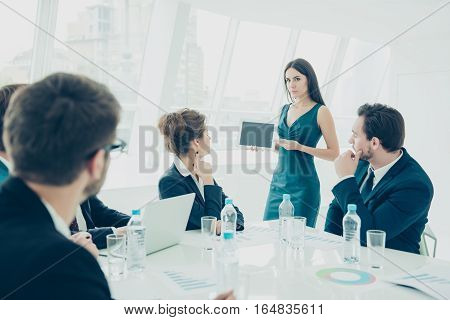 Briefing. Young Woman Making Presentation Of  New Digital Device