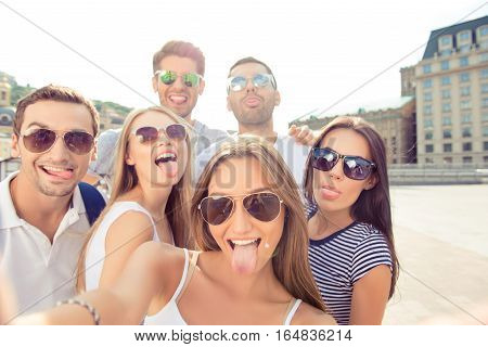 On Weekend Boyfriends And  Girlfriends   Make Selfie Photo And Showing  Tongue Out At Camera