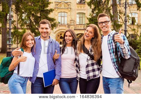 Portrait Of Group Of Happy Students Showing Thumbs Up