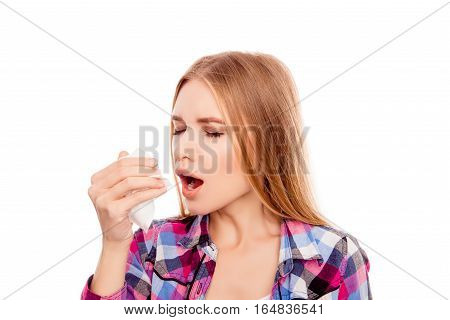 Portrait Of Sick Blonde Woman  With Fever Sneezing In Tissue