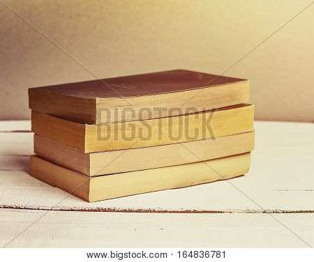 Old Books Background. Books on wooden shelf. Copy space. Vintage style toned image