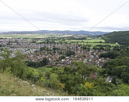 Small town surrounded by countryside with mountainous background, British Village  quaint