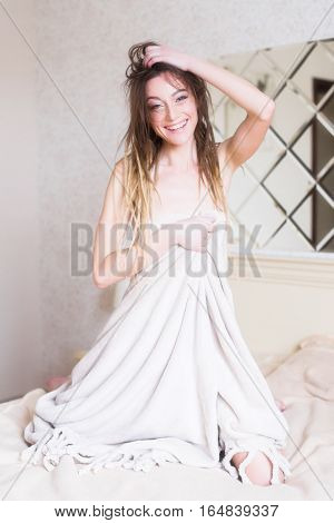 Portrait Of Sexy Woman In Bedroom. Happy Smiling Girl In Bed Covered With Blanket.