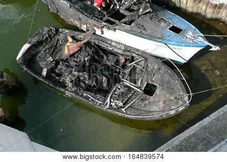 n-us-fl  Miami, Florida - 2008-05-12:  Miami River Area - Fire Damaged Fishing Boats