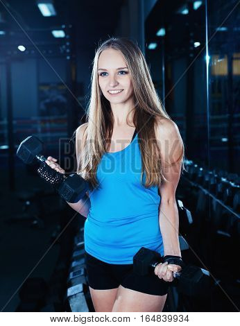 Attractive Sporty Girl Doing Workout With Dumbbells In Gym. Beautiful Fitness Woman Working On Her B