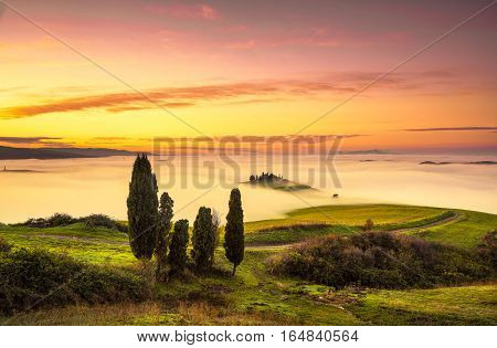Volterra fog and sea of clouds rolling hills panorama on sunset. Tuscany Italy Europe