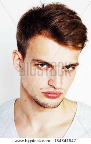 young handsome man on white background gesturing, pointing, posing emotional, cute guy sexy close up