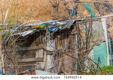Abandoned shack made of old wood and sheet-metal
