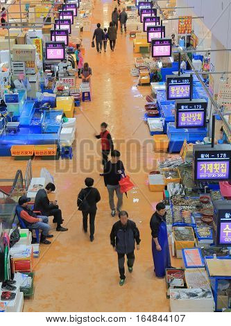 SEOUL SOUTH KOREA - OCTOBER 23, 2016: Unidentified people visit Noryanging fisheries wholesale market. Noryanging fisheries wholesale market is one of Korea's largest seafood markets opened in 1929