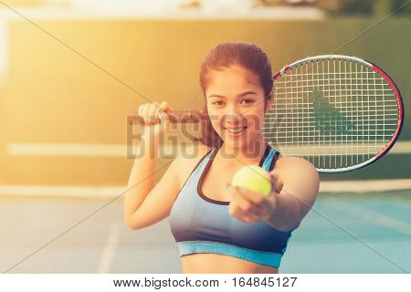 Woman in sportswear serves tennis ball. Tennis player holding tennis ball, women playing tennis, tennis sport, racket in hand woman, tennis ball in hand woman