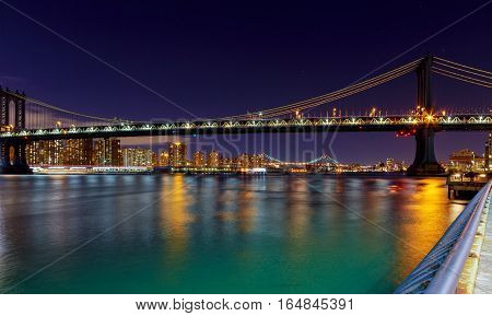 Panorama of Manhattan Bridge in New York City at night Brooklyn and Manhattan and Williamsburg bridges span across the East River