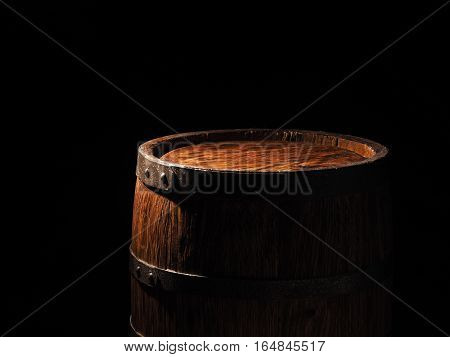 Old Barrel With Cognac On Wooden Backgroun